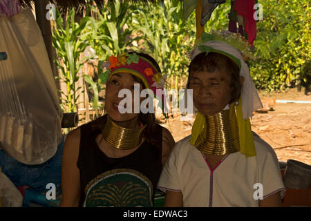 Long neck hill tribe women with a tourist near Chiang Rai in Northern Thailand - Stock Photo