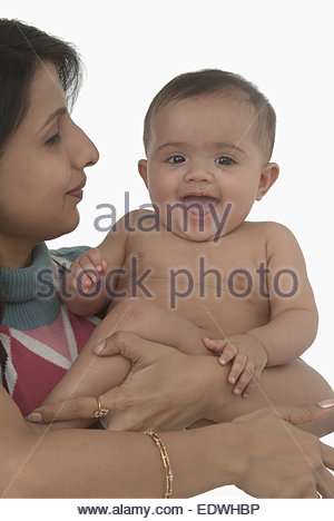 Indian woman carrying her son - Stock Photo