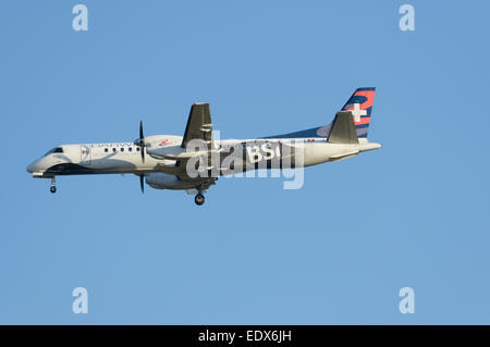 Darwin Airlines Saab 2000 on final approach - Stock Photo