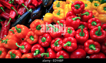Sweet Peppers and Chillies on a fruit and veg stand. Close up - Stock Photo