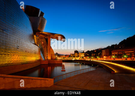 Guggenheim Museum Bilbao, by Frank Gehry, the Nervion River, Bilbao, Basque Country, Biscay Province, Spain - Stock Photo