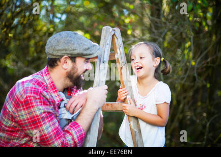 Portrait of father and daughter, Munich, Bavaria, Germany - Stock Photo