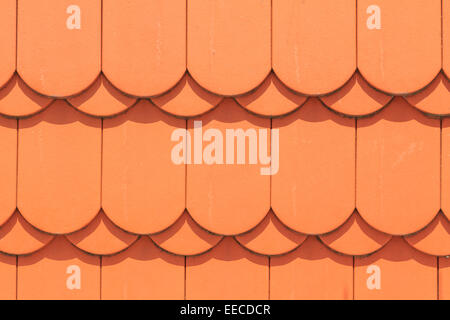 Closeup of orange rounded roof tiles - Stock Photo