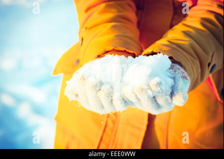 Snow in Woman Hands giving Winter Lifestyle vacations Outdoor - Stock Photo