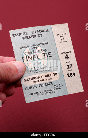 Hand holding a World Cup Final 1966 England v West Germany ticket - Stock Photo