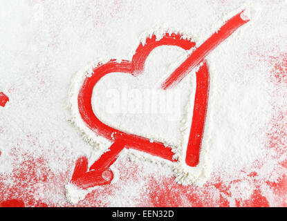 Heart with arrow drawn in the white flour. - Stockfoto