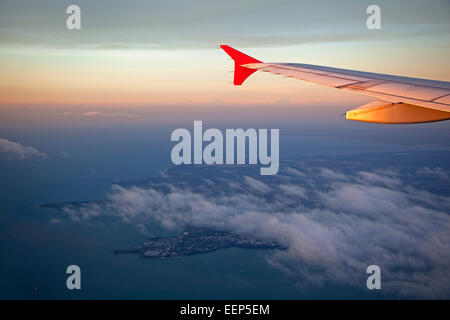 Aerial view from airplane over the city Darwin at sunset, Northern Territory, Australia - Stock Photo
