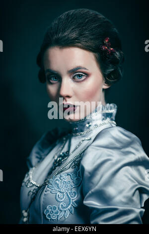 Woman in victorian dress - Stock Photo