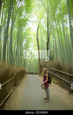 Woman in Bamboo grove - Stock Photo