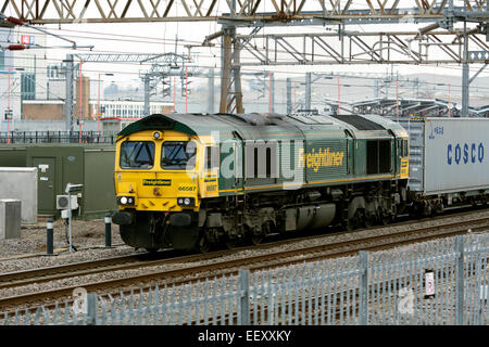 Class 66 diesel locomotive pulling freightliner train at Rugby, Warwickshire, UK - Stock Photo