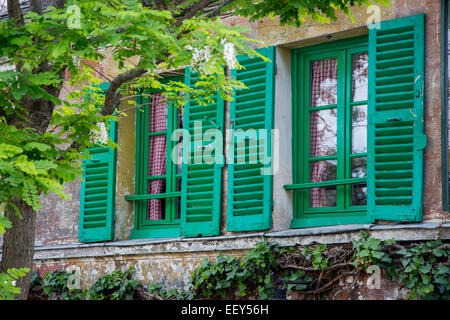 Green shuttered window on Lapin Agile - historic Cabaret in Montmartre, Paris, France - Stock Photo