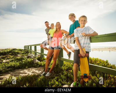 USA, California, Laguna Beach, Portrait of family with three children (6-7, 10-11, 14-15) on vacation - Stock Photo