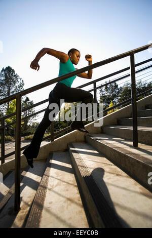 USA, California, Berkeley, Woman running on steps - Stock Photo