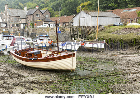 A fishing boat, high and dry, at low tide in Newhaven Harbour Stock Photo, Royalty Free Image ...