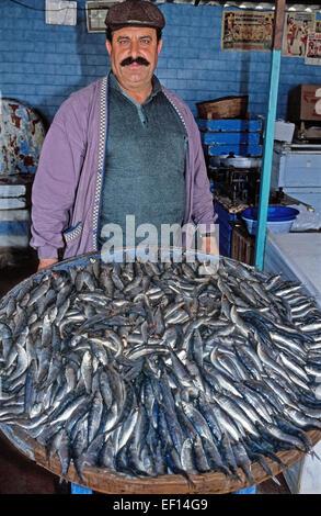 Fishmonger selling sardines at fish market near rialto for Nearest fresh fish market