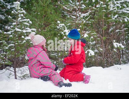 Young girls playing in new snow while out for a walk. SCO 9435. - Stock Photo
