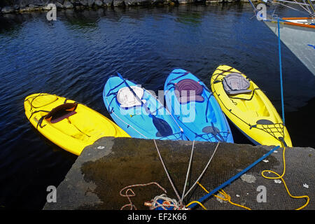 Colourful Canoes or Kayaks tied up at a pier on Lough Derg Tipperary Ireland - Stock Photo