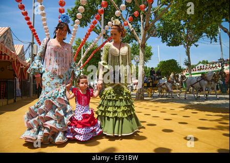 Flamenco dancers and little girl at the Feria de Abril, Seville, Andalucía, Spain - Stock Photo