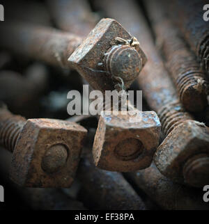 rusting nuts and bolts - Stock Photo