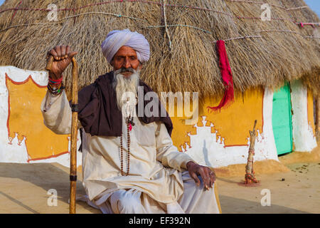 Unidentified senior indian man lives in a traditional village house with his family near Jasialmer,Rajasthan - Stock Photo