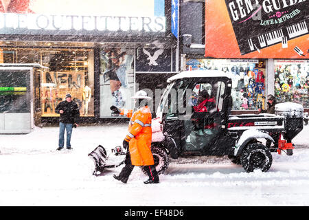 New York, USA. 26th Jan, 2015. Workers clean up snow in Times Square in New York, the United States, Jan. 26, 2015. - Stock Photo