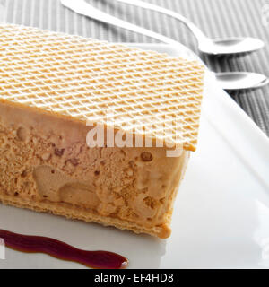 typical spanish helado al corte or corte de helado, ice cream sandwich with wafers, served with syrup - Stock Photo
