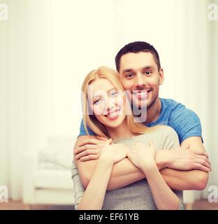 smiling couple hugging - Stock Photo