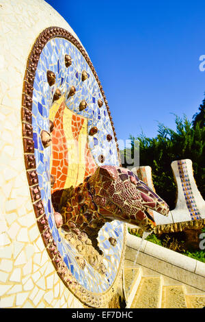 Mosaic dragon's head water fountain. Park Guell designed by Antoni Gaudi architect. Barcelona, Catalonia, Spain. - Stock Photo