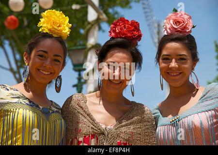 Flamenco dancers at the Feria de Abril, Seville, Andalucía, Spain - Stock Photo