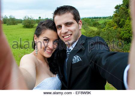 bride and groom taking selfie - Stock Photo