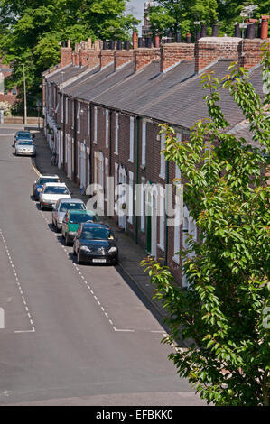 High view over rooftops of quaint, attractive, Victorian terraced houses in conservation area & cars parked  on - Stock Photo