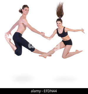 couple man and woman exercising fitness jumping on white background - Stock Photo