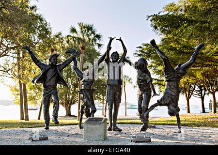 Statue of children playing called Olympic Wannabees Bayfront Park Sarasota, FL. - Stock Photo
