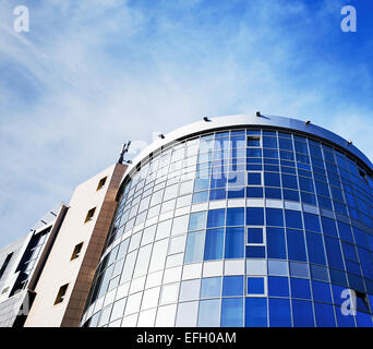 Modern office building made of glass and steel - Stock Photo