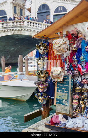 Masks for sale on souvenir stall near Rialto Bridge Venice Veneto Italy Europe - Stock Photo