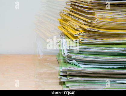 Seeing double/double vision - A large pile of school exercise books for marking by a teacher - Stockfoto