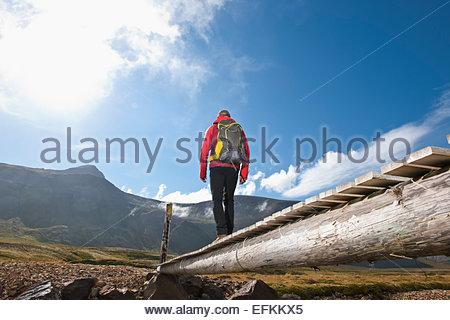 A Hiker On Wooden Footbridge In The Pemigewasset