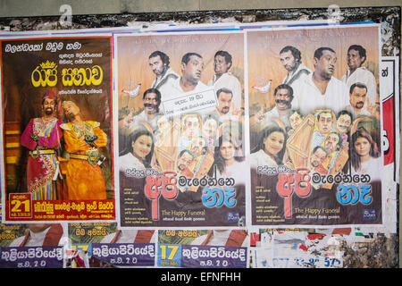 Bollywood style cinema movie posters on wall in centre of Colombo,Sri Lanka,Asia - Stock Photo