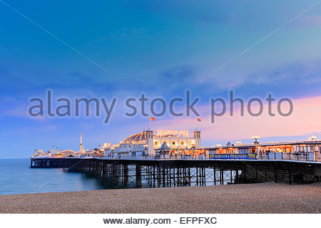 The Palace Pier (Brighton Pier) at dusk, Brighton, East Sussex, England, United Kingdom, Europe - Stock Photo