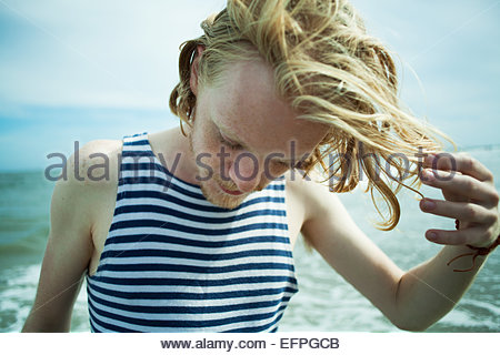 Young man enjoying beach - Stock Photo