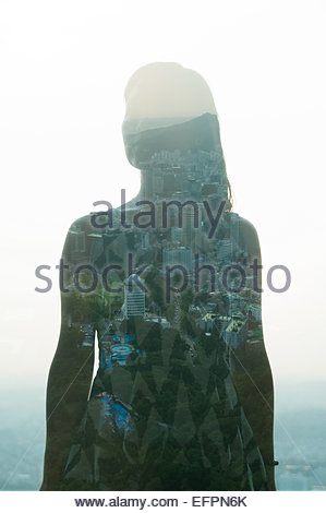 Mid adult woman and city, double exposure. - Stockfoto