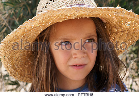 Five Year Old Toddler Boy Child Age 5 Years Portrait Headshot Head And Shoulders Face Portrait Wearing Hat Thinking - Stock Photo