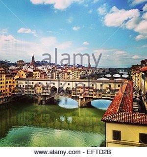 Ponte Vecchio and surrounding cityscape - Stock Photo