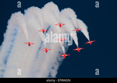 The Red Arrows performing a formation loop - Stock Photo