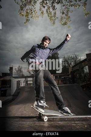 Skateboarding on mini ramp, Smith grind, Berlin, Germany - Stock Photo