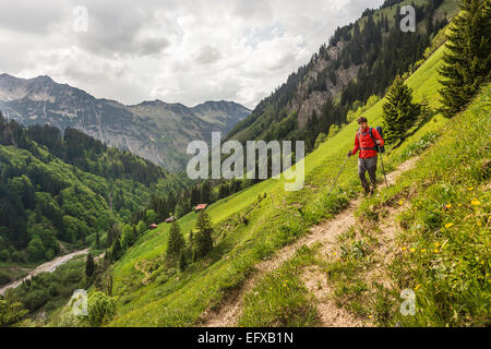 Young man hiking on valley path, Oberstdorf, Bavaria, Germany - Stock Photo