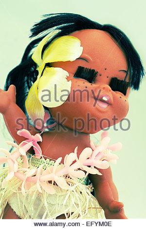 Hawaiian smiling posed hula girl toy plastic doll - Stock Photo