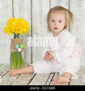 portrait of a little girl with Down syndrome - Stock Photo