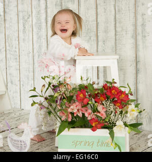 Laughter girl with Down syndrome - Stock Photo