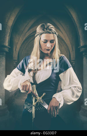 Medieval woman with a dagger - Stock Photo